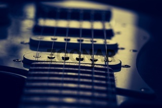 Close up of electric guitar element. Abstract photo.