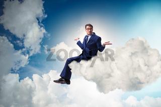 Businessman sitting on the cloud in motivitation concept