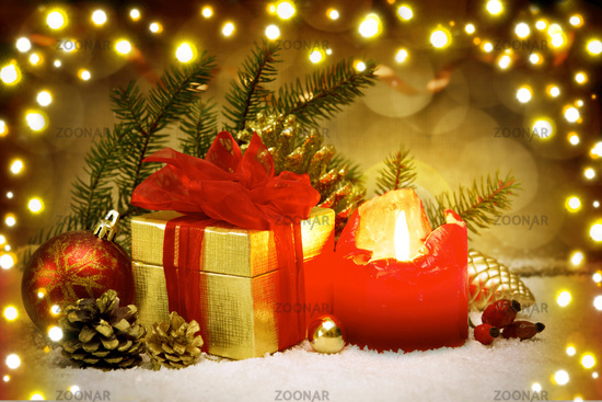 Advent candle and golden gift box.