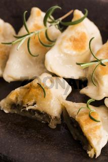 Polish pierogi filled with cabbage and mushrooms