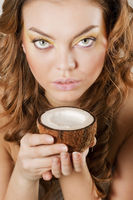 Young woman drinking coconut milk