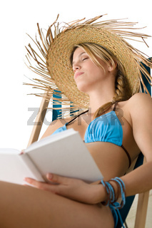 Beach - Happy young woman relax with book