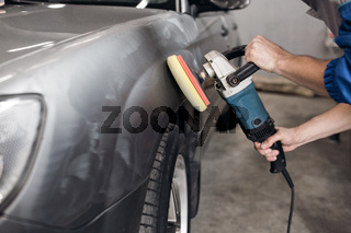 man polishing cleaning car with microfiber cloth, detailing or valeting concept