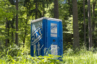 Mobile toilet cabin in the forest