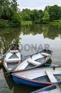 Boats by the lake shore in Kurpark, Wiesbaden, Hesse, Germany