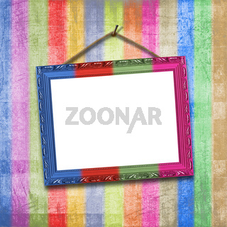 Wooden multicolored framework for portraiture on the striped background