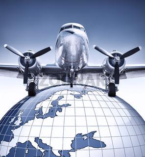 flugzeug auf einem globus