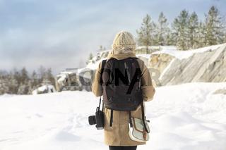 Professional female film photographer in Karelia, Russia