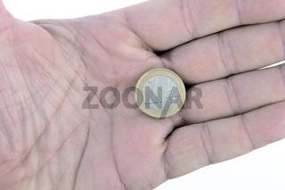 Muenze, ein Euro in einer Hand