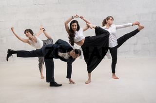 A man and women in office clothes doing yoga