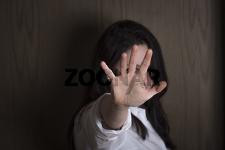 Woman with hand stretched as a stop symbol