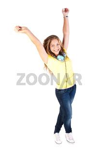 Young girl enjoying music through headphones