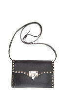 Fashionable Italian bag with spikes on a white background