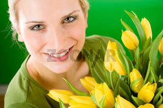 Young woman hold yellow tulips flower