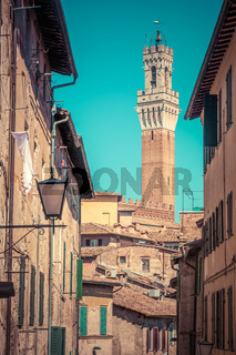 Siena, Italy. Mangia Tower, Italian Torre del Mangia. Tuscany region. Vintage