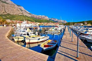 Colorful Makarska harbor and waterfront under Biokovo mountain view