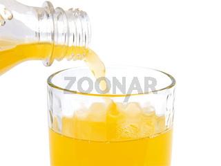 Fresh orange juice pouring in glass