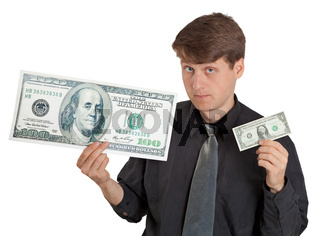 Young man holding large and small money