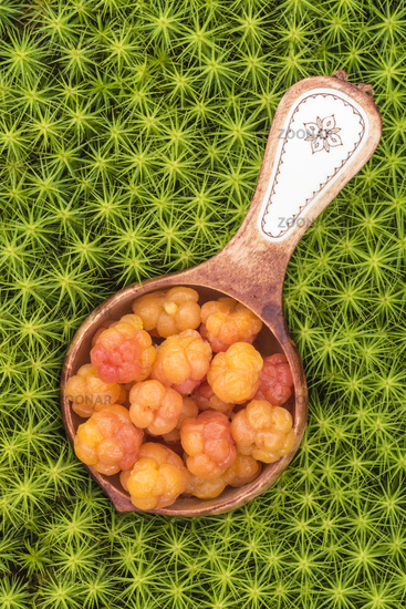 Cloudberries in a wooden bowl, Lapland, Sweden