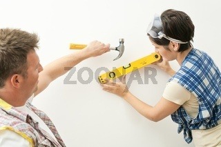Couple working together at home