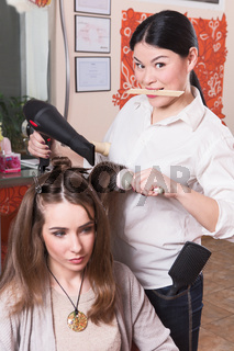 Beautiful lady in hairdressing saloon