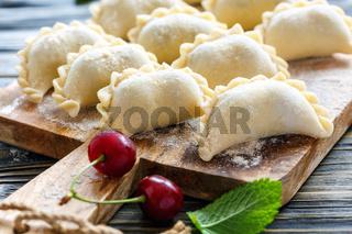 Dumplings with fresh cherries for cooking.