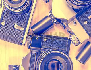 Old vintage photo-cameras, tape cassettes.