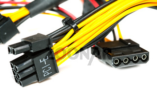 connecting wires to a computer on a white background