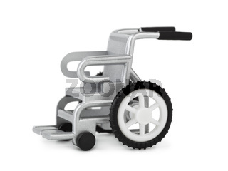 Toy wheelchair isolated on white background