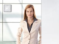 Portrait of confident businesswoman smiling