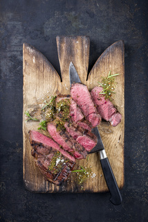 Barbecu Point Steak on old Cutting Board