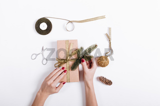 Female hands packed and decorated boxes with gifts