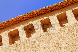 Rammed earth wall with beautiful blue sky