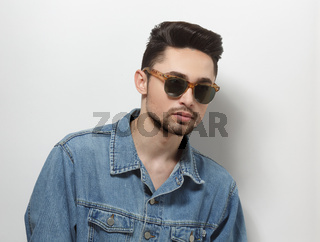 Man with modern hairstyle in studio