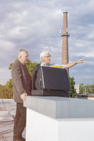 Senior businessmen discussing business on the roof of a building