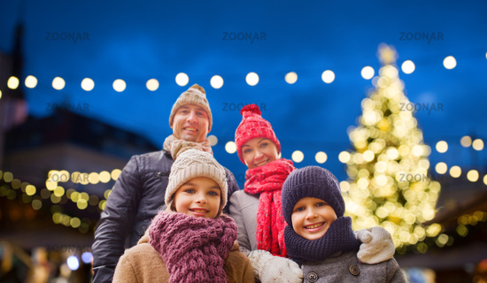 happy family outdoors at christmas eve