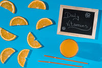Orange slices and organic juice for daily vitamins
