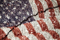 USA flag on cracked asphalt