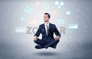 Businessman levitates with data circulation concept