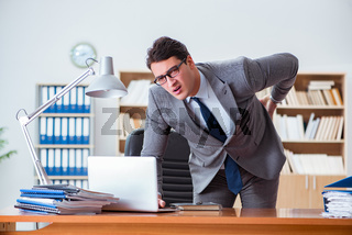 Businessman feeling pain in the office