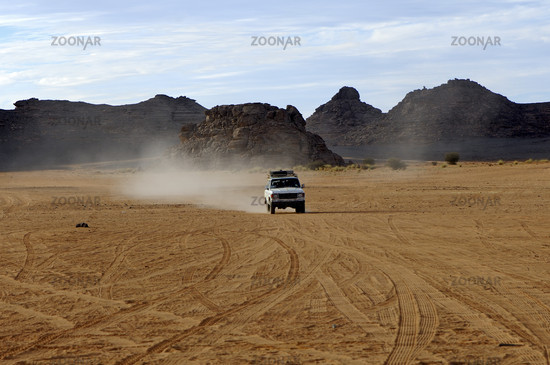 Four-wheel drive jeep on a desert road