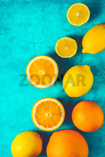 Lemons and oranges on the cyan background vertical