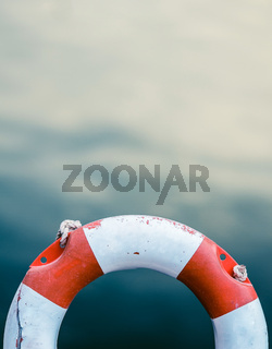Grungy Lifebuoy Against Ocean Water