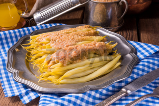 yellow string bean with bread crumbs