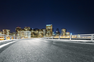 empty road with modern city at night