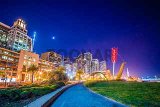 Cupid's Span statue by famous artists Claes Oldenburg and Coosje van Bruggen in Rincon Park with the city as a backdrop, on April 2017 in San Francisco