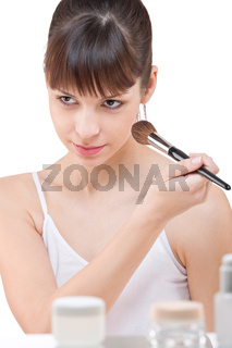 Body care: Young woman applying powder