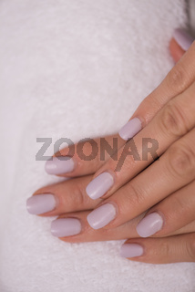woman fingers with french manicure