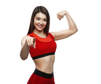 Cheerfully smiling mixed race sporty woman demonstrating biceps