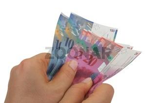 Schweizer Franken Banknoten festhalten